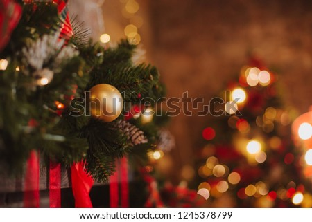 christmas decorative backgrounds with star gifts toys garland and bokeh lights holiday concept #1245378799
