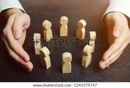 Boss defending his team with a gesture of protection. Life insurance. Customer care, care for employees. Security and safety in a business team. Human resources. A responsibility. Social protection Royalty-Free Stock Photo #1245379747
