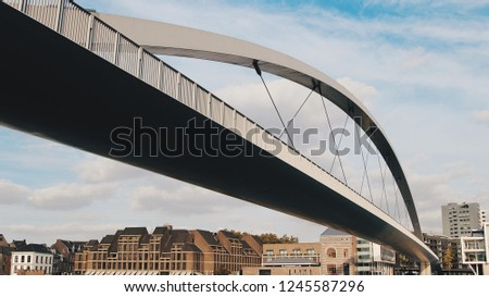 Modern bridge with arched structure  #1245587296