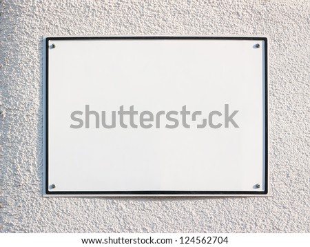 blank sign at a wall - nice background with space for text