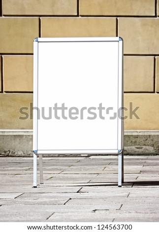 blank white board at a sidewalk
