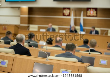 Session of Government. Conference room or seminar meeting room in business event. Academic classroom training course in lecture hall. blurred businessmen talking. modern bright office indoor Royalty-Free Stock Photo #1245681568