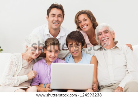 Multi-generation family on couch with laptop #124593238