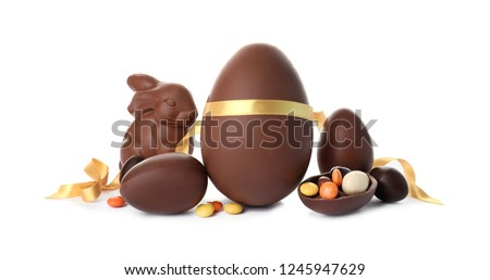 Composition with chocolate Easter eggs on white background Royalty-Free Stock Photo #1245947629