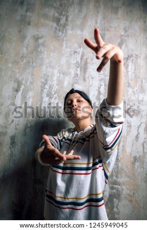 rap girl preparing for a concert. close up photo. rap gesture , dancing battle concept. subculture #1245949045