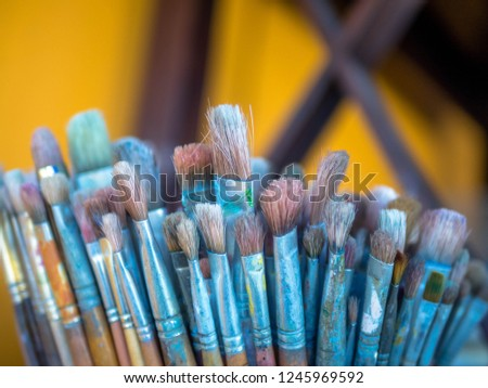 So many Brushes in a glass jar on the table #1245969592