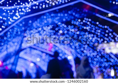 BLUE Bokeh of a street with people on christmas day or New year #1246002160