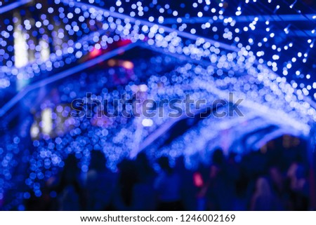 BLUE Bokeh of a street with people on christmas day or New year #1246002169