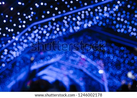 BLUE Bokeh of a street with people on christmas day or New year #1246002178