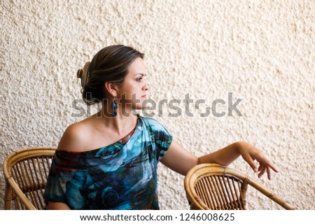 Profile of woman in chair #1246008625