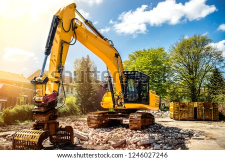 Excavator at construction site demolition detached house Royalty-Free Stock Photo #1246027246