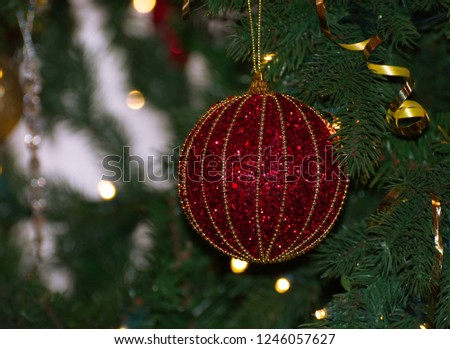 Red and gold ball / bauble decoration / ornament hanging on a real Christmas tree #1246057627
