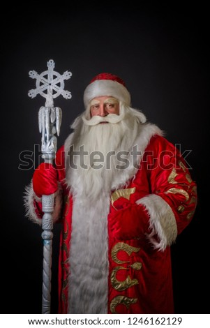 Santa Claus and Santa Claus on a black background. Santa Claus and Santa Claus are majestic and original with a staff on a black background. #1246162129