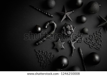 Christmas minimalistic and simple composition in mat black color. Christmas gifts, decorations on black background. Flat lay, top view with copy space #1246250008