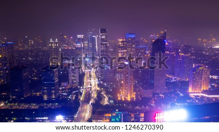 JAKARTA - Indonesia. November 28, 2018: Top view of modern high building and highway with night light in Jakarta downtown #1246270390