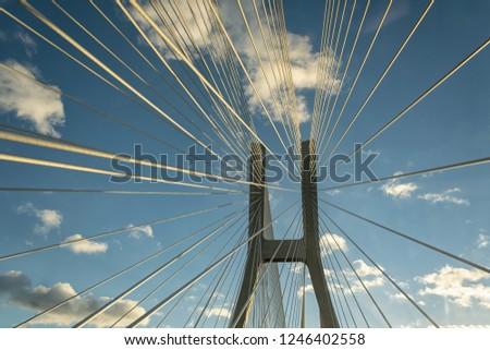 Pillar of suspended bridge against the blue sky. #1246402558