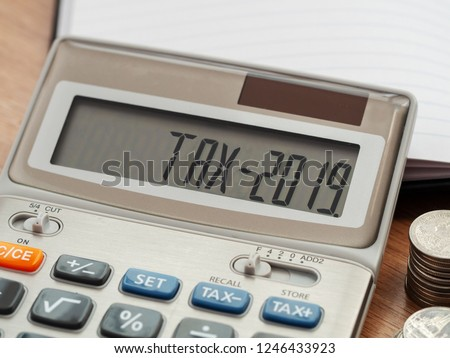 Tax word and 2019 number on calculator. Business and tax concept. Pay tax in 2019 years. #1246433923