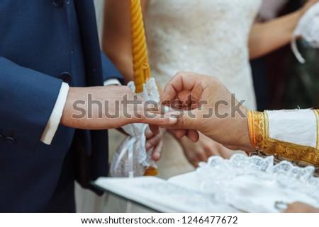wedding in the church dressing gold wedding rings shepherd bride and groom #1246477672