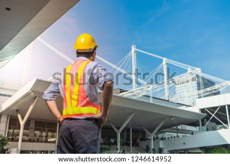 Civil Engineer supervised the construction of  roof frame and pile of concrete on construction sites in operation and project complete. #1246614952