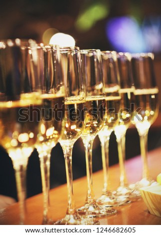Sparkling wine glasses champagne stand in row at the bar, catering #1246682605