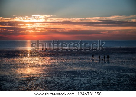 Sunset at Westward Ho!  Royalty-Free Stock Photo #1246731550
