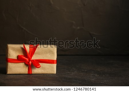 Gift Box with Ribbon - craft paper  (dark background). top view, copy space #1246780141