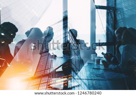 Silhouette of business people work together in office. Concept of teamwork and partnership. double exposure with light effects #1246780240