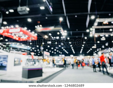 Defoused bokeh lights background of event exhibition, Business show concept. #1246802689