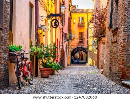Cozy narrow street in Ferrara, Emilia-Romagna, Italy. Ferrara is capital of the Province of Ferrara #1247082868