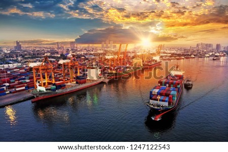 Logistics and transportation of Container Cargo ship and Cargo plane with working crane bridge in shipyard at sunrise, logistic import export and transport industry background #1247122543