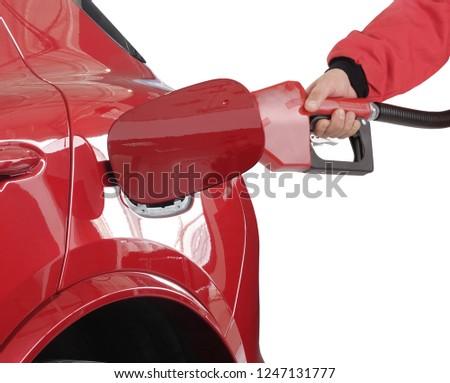 Gasoline pistol pump gun fuel nozzle and car on gas station #1247131777