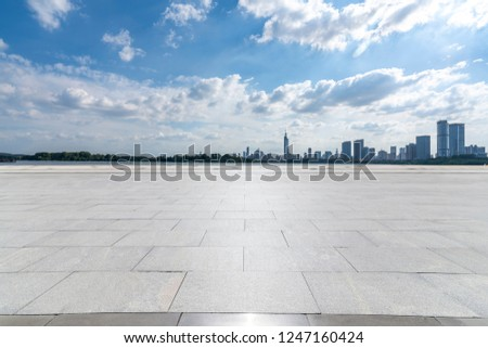 Panoramic skyline and modern business office buildings with empty road,empty concrete square floor #1247160424