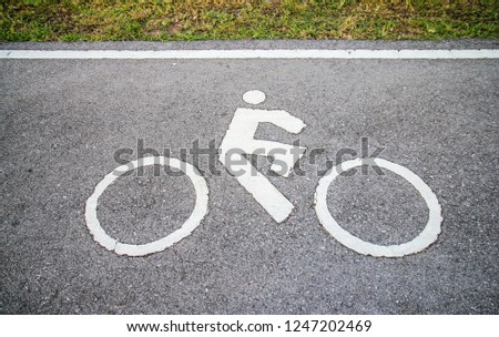 cyclist sign lane on the asphalt road background #1247202469