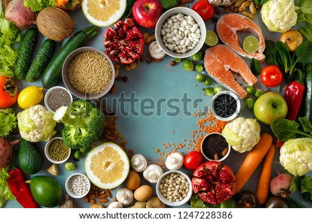Top view frame of healthy and diet food (cereals, seeds, fish, vegetables and fruits). Healthy and diet menu of restaurant concept #1247228386