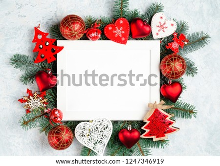 christmas or new year frame composition. christmas decorations in red colors on white background with empty copy space for text. holiday and celebration concept for postcard or invitation. top view #1247346919