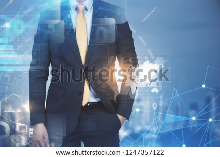 Businessman standing with his hand in pocket over night cityscape background with business infographics interface. Toned image double exposure Elements of this image furnished by NASA #1247357122