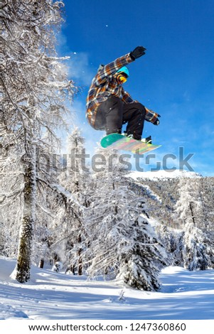 jump with snowboard in fresh snow #1247360860