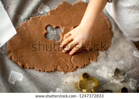 Kids are cooking Christmas cookies #1247372833