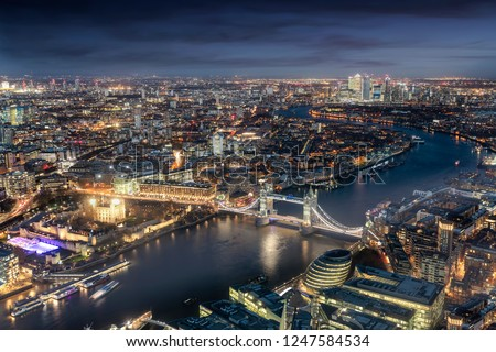 Panoramic view of London: from the Tower Bridge to the financial district Canary Wharf during evening time #1247584534
