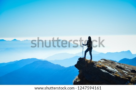 Capturing a silhouette of a girl while doing the Chandrashila trek in the Uttarakhand state of India  Royalty-Free Stock Photo #1247594161