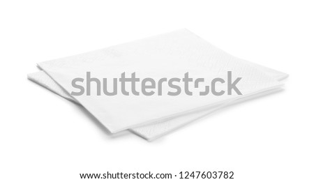 Clean paper napkins on white background. Personal hygiene #1247603782