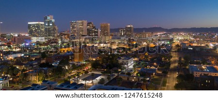 Dusk comes as night falls on the buildings in the downtown urban core of Phoenix Arizona