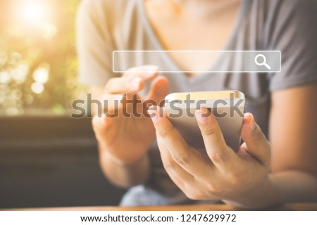 Women use smartphones to find what they are interested in. Searching information data on internet networking concept #1247629972