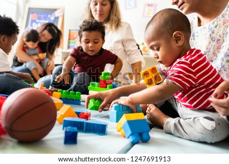 Diverse children enjoying playing with toys Royalty-Free Stock Photo #1247691913