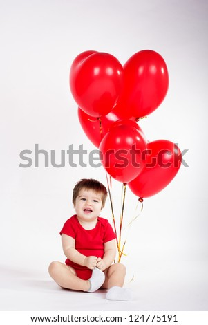 Little baby boy with red balloons. Valentines day #124775191