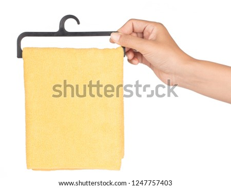 hand holding towel on a hanger isolated on a white background. #1247757403