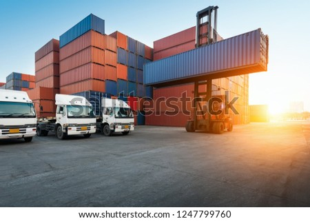 Industrial Container yard with forklift working in the morning for logistic import export background #1247799760