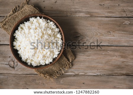 Organic Farming Cottage cheese on rustic wooden background, copy space. Homemade cottage cheese for eating healthy diet food. #1247882260