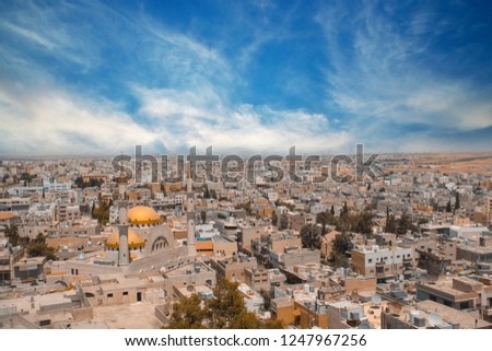 wide shot view over the town center of Madaba in Jordan with the Central Mosque. Landscape of Jordan #1247967256