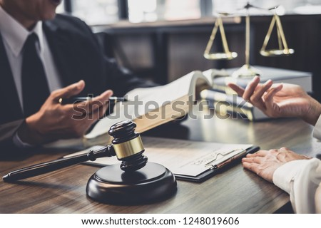 Good service cooperation, Consultation of Businesswoman and Male lawyer or judge counselor having team meeting with client, Law and Legal services concept. #1248019606
